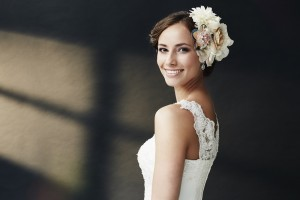 Glamorous young bride in wedding dress, smiling